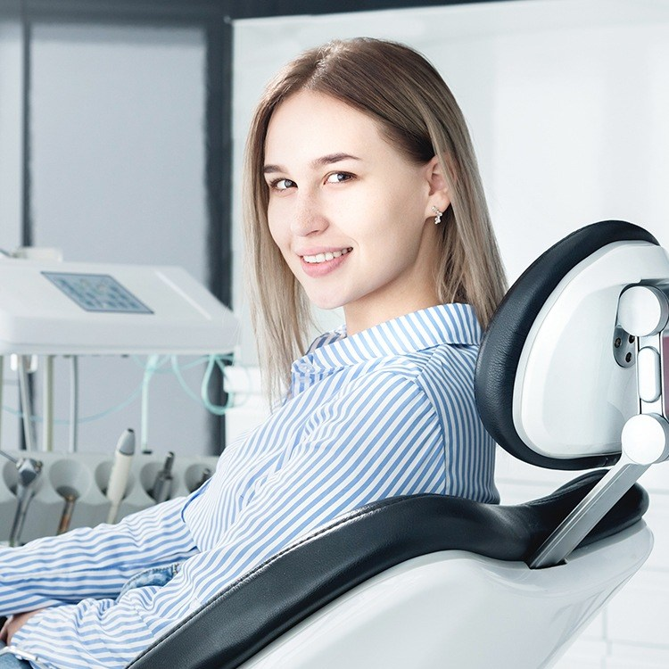 Woman in dental chair during preventive dentistry appointment