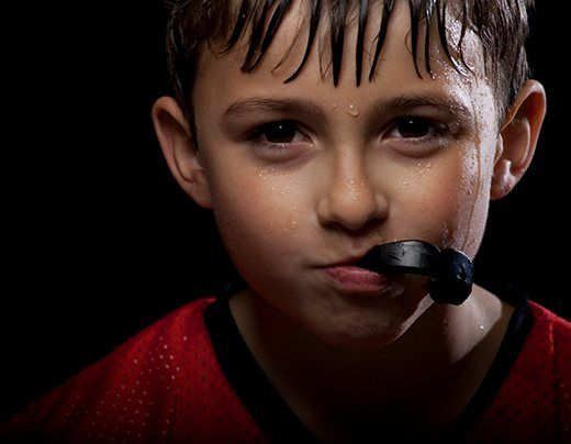 Teen boy with athletic mouthguard