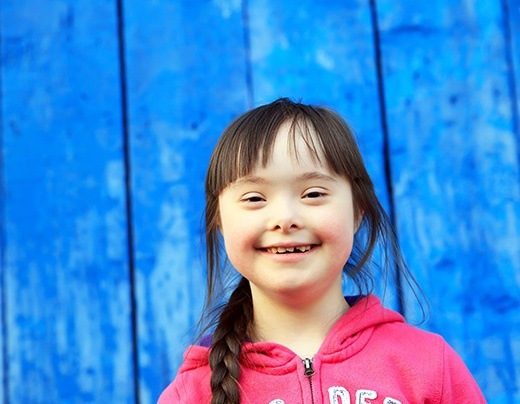 Young girl smiling after special needs dentistry appointment