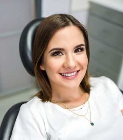 Smiling woman in dentist's office during dental checkup