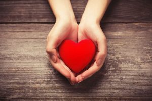 Heart in hands for American Heart Month